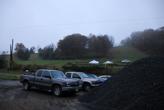 fog, hill, parking lot, rock pile of crap, rocks, ski slope, trucks, woods