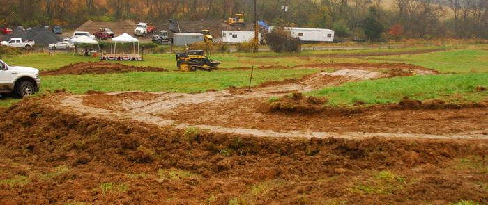 burm, downhill mountain bike track, field, fog, grass, mud, race track, track, tractor