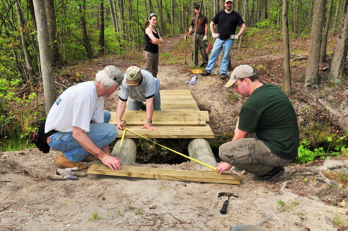bridge, building, planks, spring, stream, trail maintenance, trees, volunteer, water, woods, tools, measuring tape