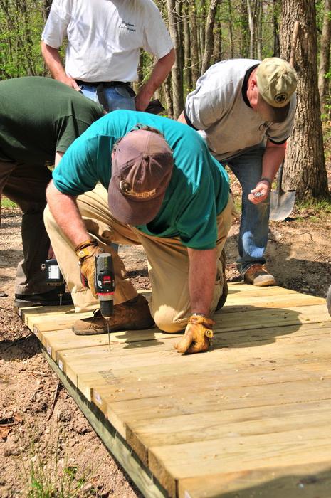 bridge, building, planks, spring, stream, tools, trail maintenance, trees, volunteer, water, woods