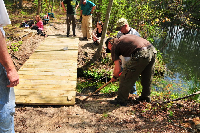 bridge, building, planks, spring, stream, trail maintenance, trees, volunteer, water, woods, tools, leverage