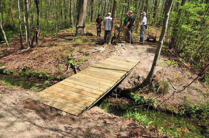 bridge, building, planks, spring, stream, trail maintenance, trees, volunteer, water