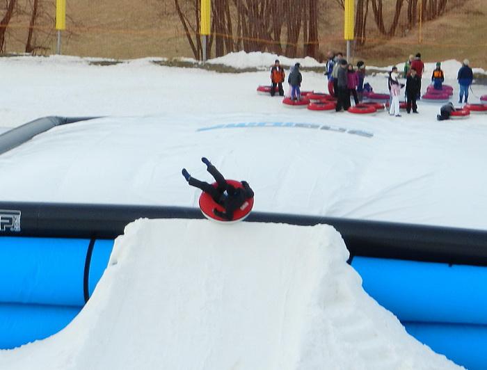 blow up landing area, jump, jumping, ramp, snow, tubing, Rob