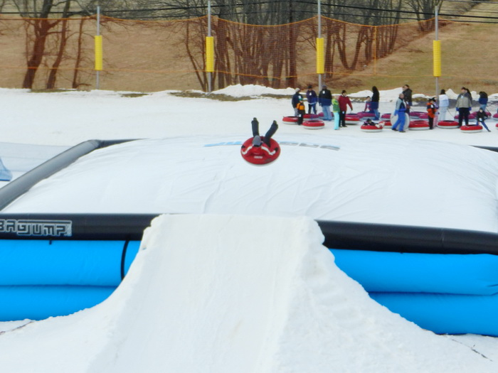 blow up landing area, jump, jumping, ramp, snow, tubing, Jackie