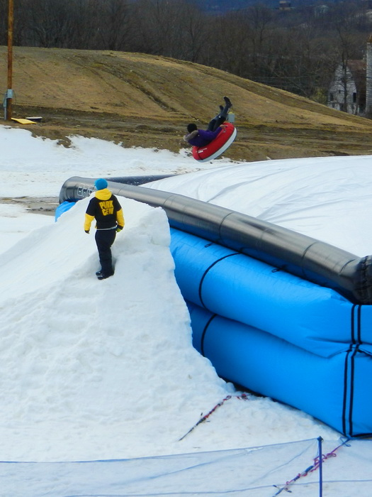ramp, snow ramp, worker, snow tubing, jump, blow up landing area, in the air line holders